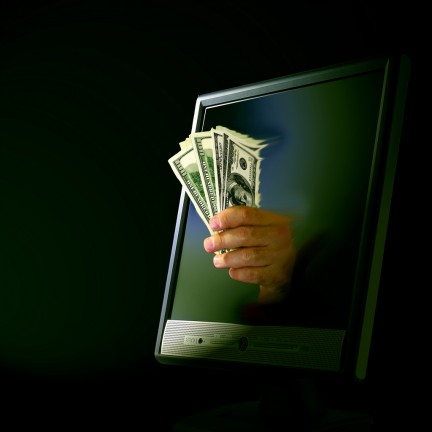 Dinero saliendo del ordenador